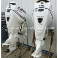USED 2009 PAIR EVINRUDE 115 HP 25 INCH SHAFT COUNTER OUTBOARD MOTOR